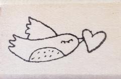 Rubbermoon bird with heart